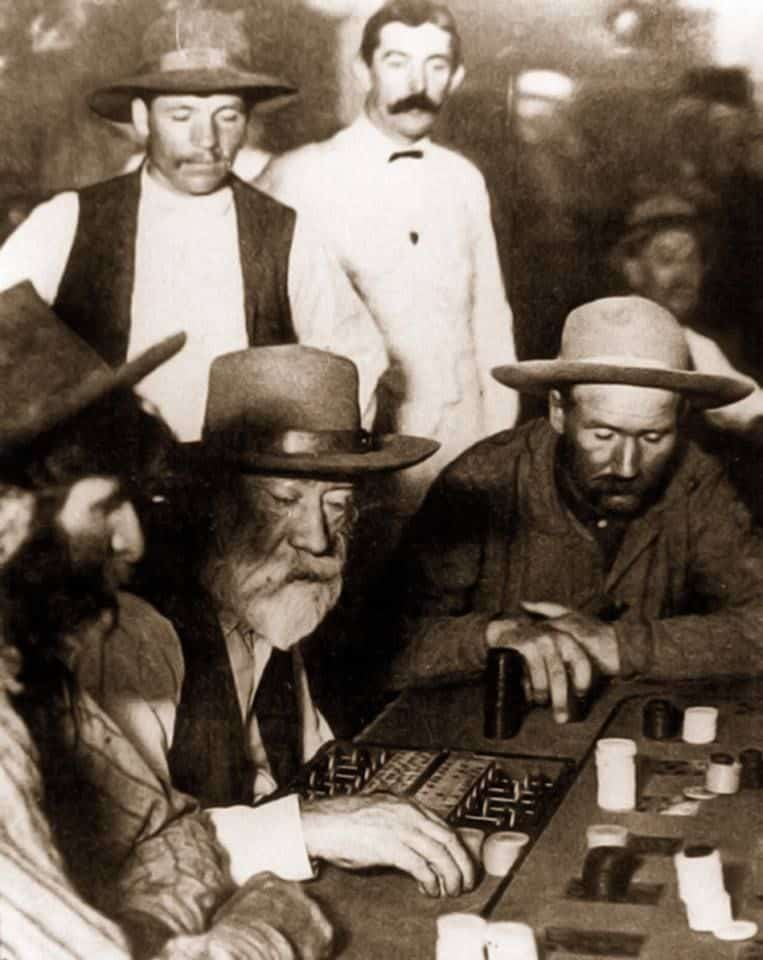men playing poker around a table