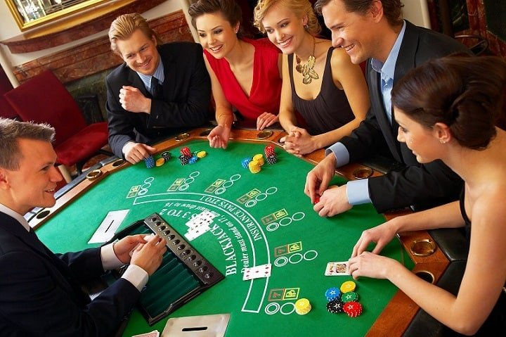 friends playing a casino game and enjoying