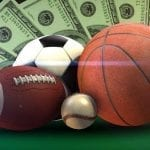 sports balls with money next to them
