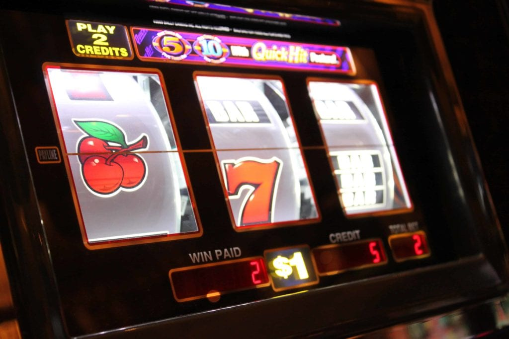 slot' spin coming to an end with the number 7 and cherries showing