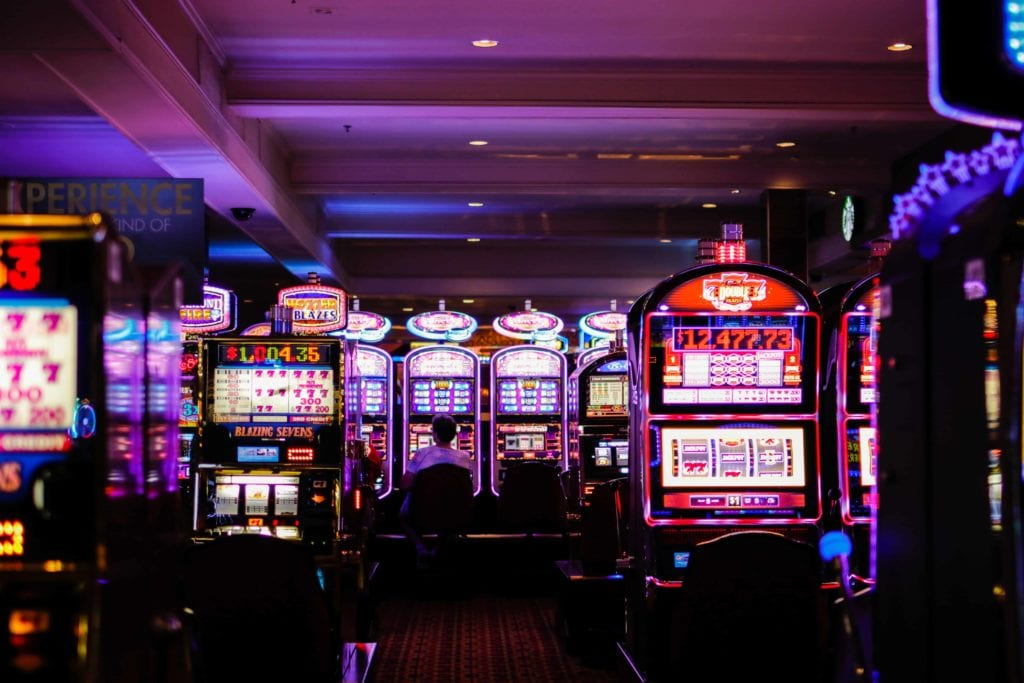 an image with a set of slot machines photographed inside of a casino