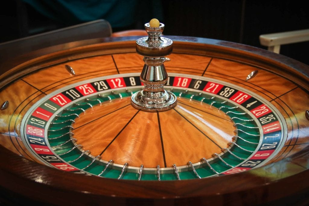 an image of a roulette table that is made of wood and has black and red squares